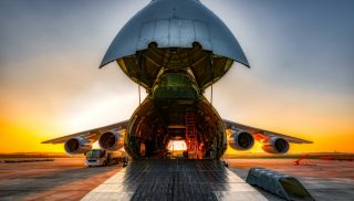Plane on the ground with wide open freight room stock photo